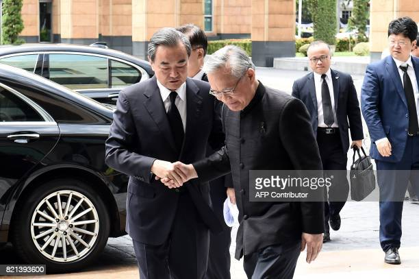 China's Foreign Minister Wang Yi shakes hands with Thai Foreign Minister Don Pramudwinai at the Ministry of Foreign Affairs in Bangkok on July 24...
