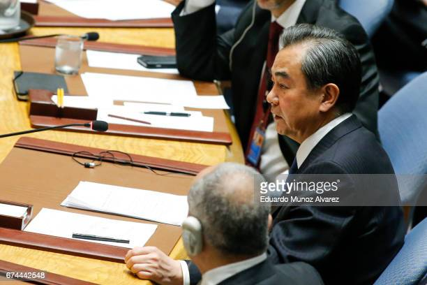 China's Foreign Minister Wang Yi speaks to members of the security council during a meeting on nonproliferation of North Korea at United Nations on...