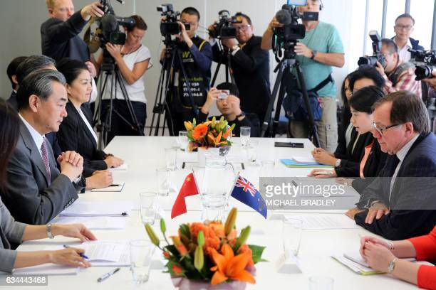China's Foreign Minister Wang Yi speaks with his New Zealand counterpart Murray McCully during a bilateral meeting in Auckland on February 10 2017 /...