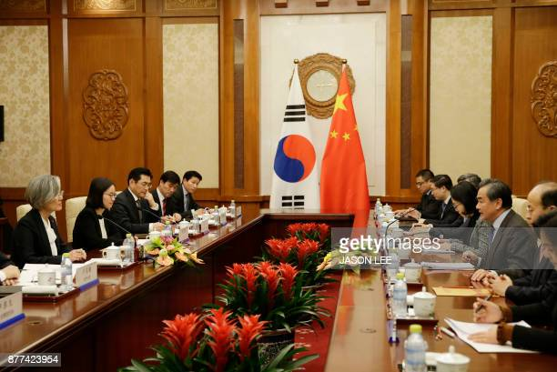 China's Foreign Minister Wang Yi speaks with South Korea's Foreign Minister Kang Kyungwha during their meeting at the Diaoyutai State Guesthouse in...