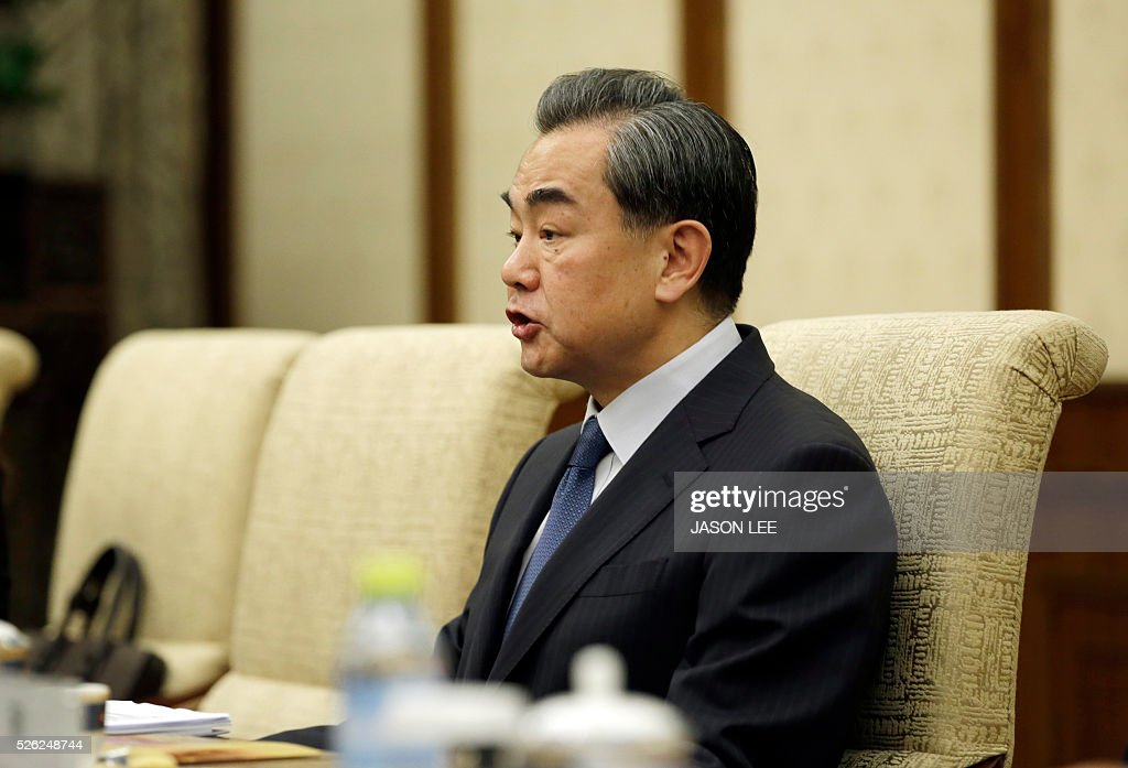 China's Foreign Minister Wang Yi talks with Japanese Foreign Minister Fumio Kishida (unseen) during a meeting at Diaoyutai State Guesthouse in Beijing on April 30, 2016. / AFP / POOL / JASON LEE