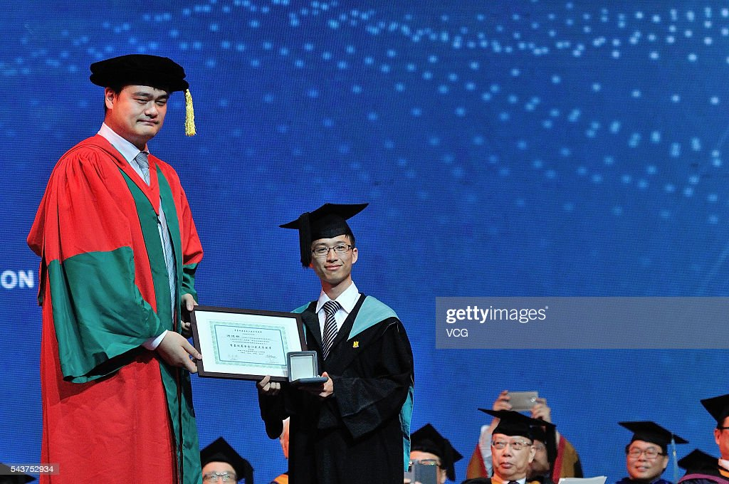 China's former NBA star <a gi-track='captionPersonalityLinkClicked' href=/galleries/search?phrase=Yao+Ming&family=editorial&specificpeople=201476 ng-click='$event.stopPropagation()'>Yao Ming</a> poses with a graduate during graduation ceremony of Shantou University on June 30, 2016 in Shantou, Guangdong Province of China. Hong Kong business magnate, investor, and philanthropist Li Ka-shing and former NBA player arrived at the graduation ceremony of Shantou University which is a key comprehensive university under the '211 Project' in the Guangdong province and also the only public university in the world that receives long-term funding from the Li Ka Shing Foundation.