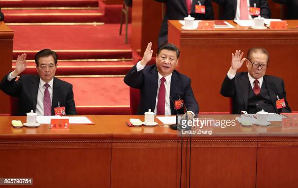 China's former president Hu Jintao Chinese President Xi Jinping and China's former president Jiang Zemin vote at the closing of the 19th Communist...