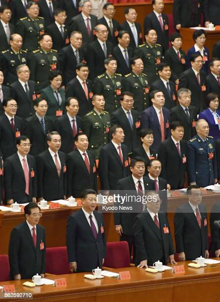 China's former President Hu Jintao President Xi Jinping former President Jiang Zemin and Premier Li Keqiang sing the national anthem at Beijing's...