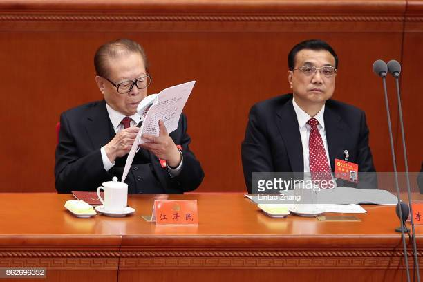 China's former president Jiang Zemin and Chinese Premier Li Keqiang attend the opening session of the Chinese Communist Party's Congress at the Great...