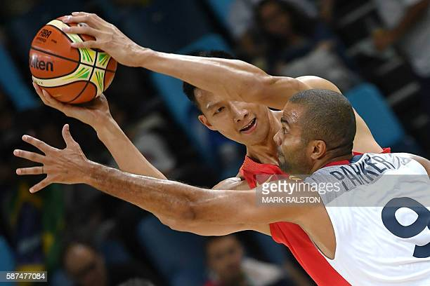TOPSHOT China's forward Yi Jianlian vies with France's point guard Tony Parker during a Men's round Group A basketball match between France and China...