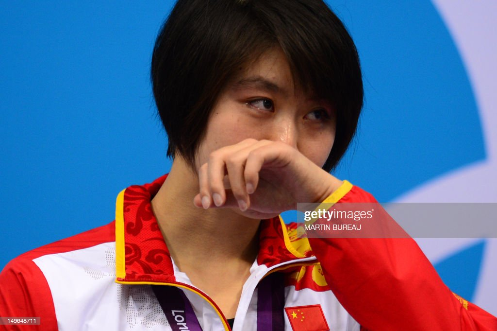China's gold medalist <a gi-track='captionPersonalityLinkClicked' href=/galleries/search?phrase=Jiao+Liuyang+-+Swimmer&family=editorial&specificpeople=4058032 ng-click='$event.stopPropagation()'>Jiao Liuyang</a> cries on the podium after the women's 200m butterfly final swimming event at the London 2012 Olympic Games on August 1, 2012 in London.