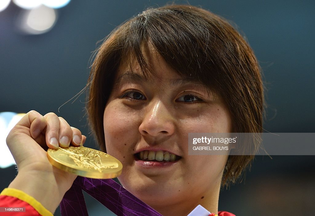 China's gold medalist <a gi-track='captionPersonalityLinkClicked' href=/galleries/search?phrase=Jiao+Liuyang+-+Swimmer&family=editorial&specificpeople=4058032 ng-click='$event.stopPropagation()'>Jiao Liuyang</a> poses on the podium after the women's 200m butterfly final swimming event at the London 2012 Olympic Games on August 1, 2012 in London.