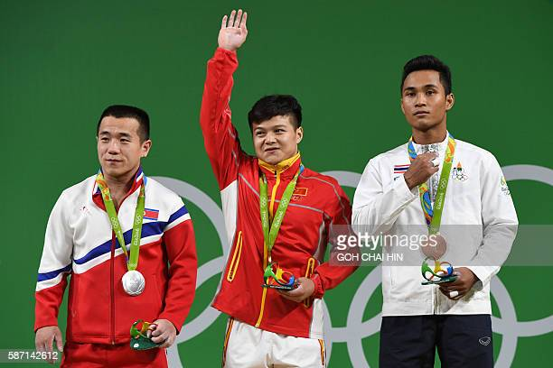 China's gold medallist Long Qingquan C North Korea's silver medallist Om Yun Chol and Thailand's bronze medalist Sinphet Kruaithong pose with their...