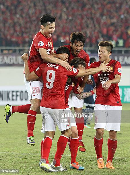 China's Guangzhou Evergrande players celebrate after beating Australia's Melbourne Victory during the AFC Champions League group G first round match...