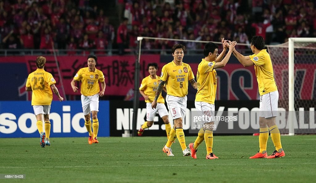 China's Guangzhou Evergrande players celebrate after scoring a goal against Japan's Cerezo Osaka during the AFC champions league round 16 match in Osaka on May 6, 2014. Evergrande led Cerezo 3-1 after the first half.