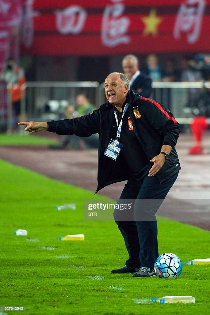 China's Guangzhou Evergrande's head coach Luiz Felipe Scolari reacts during the AFC Champions League group stage football match against Australia's Sydney FC in Guangzhou, in China's Guangdong province on May 3, 2016. / AFP / STR