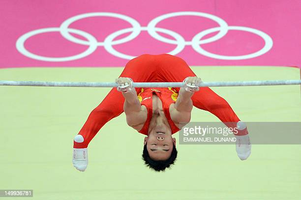China's gymnast Zou Kai performs during the men's horizontal bar final of the artistic gymnastics event of the London Olympic Games on August 7 2012...