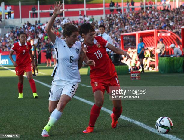 China's Han Peng and US player Kelley O' Hara fight for the ball during their 2015 FIFA Women's World Cup quarterfinal match at Lansdowne Stadium in...