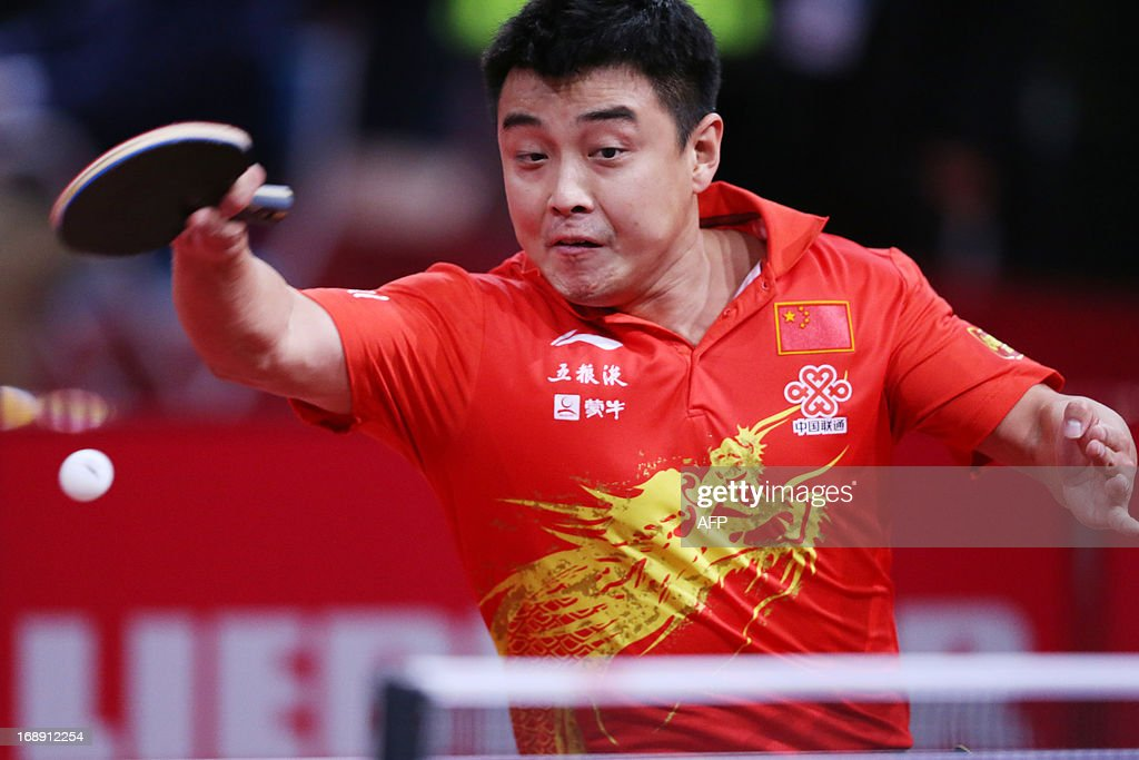 China's Hao Wang plays against Hong Kong's Yuk Cheung on May 16, 2013 in Paris, during the second round of the Men's Singles of the World Table Tennis Championships.