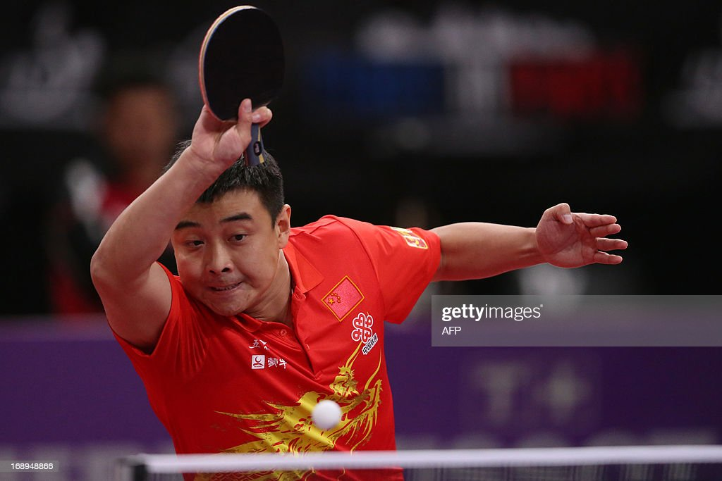 China's Hao Wang plays against Iran's Noshad Alamyan, on May 17, 2013 in Paris, during the third round of Men's Singles of the World Table Tennis Championships. AFP PHOTO/THOMAS SAMSON
