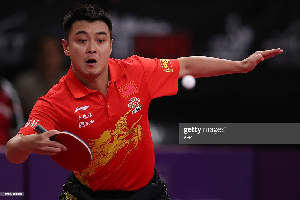 China's Hao Wang plays against Iran's Noshad Alamyan, on May 17, 2013 in Paris, during the third round of Men's Singles of the World Table Tennis Championships.