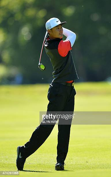 China's Haotong Li watches his drive from the 17th fairway during the first round of the PGA Championship at Wentworth Golf Club in Surrey south west...