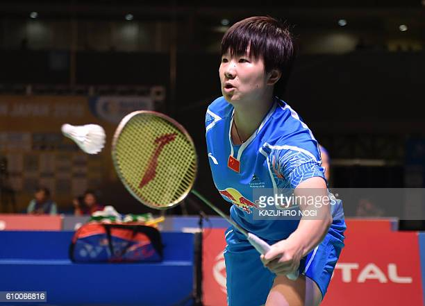 China's He Bingjiao returns a shot against Japan's Aya Ohori during their women's singles semifinal match at the Japan Open badminton tournament in...