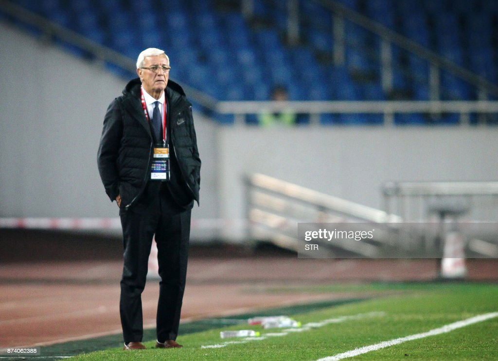 China's head coach Marcello Lippi looks on during their international friendly football match against Colombia in Chongqing, southwest China on November 14, 2017. A Colombia side missing James Rodriguez punished China 4-0 away in a friendly on November 14 as coach Jose Pekerman made wholesale changes from the team defeated in acrimony in South Korea. / AFP PHOTO / STR / China OUT
