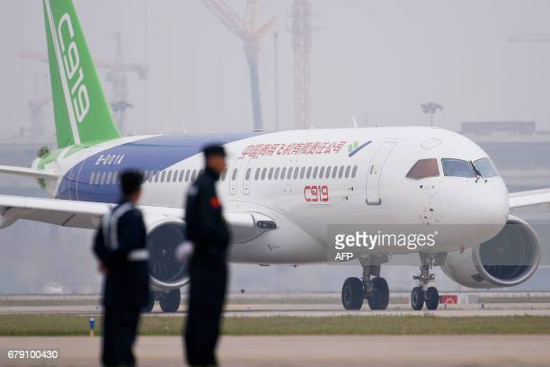 China's homegrown C919 passenger jet taxis after its maiden flight at Pudong International Airport in Shanghai on May 5 2017 The first large...