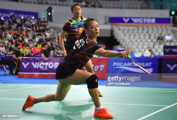 China's Huang Yaqiong plays a shot as her partner Yu Xiaohan looks on while playing against Japan's Misaki Matsutomo and Ayaka Takahashi during their...