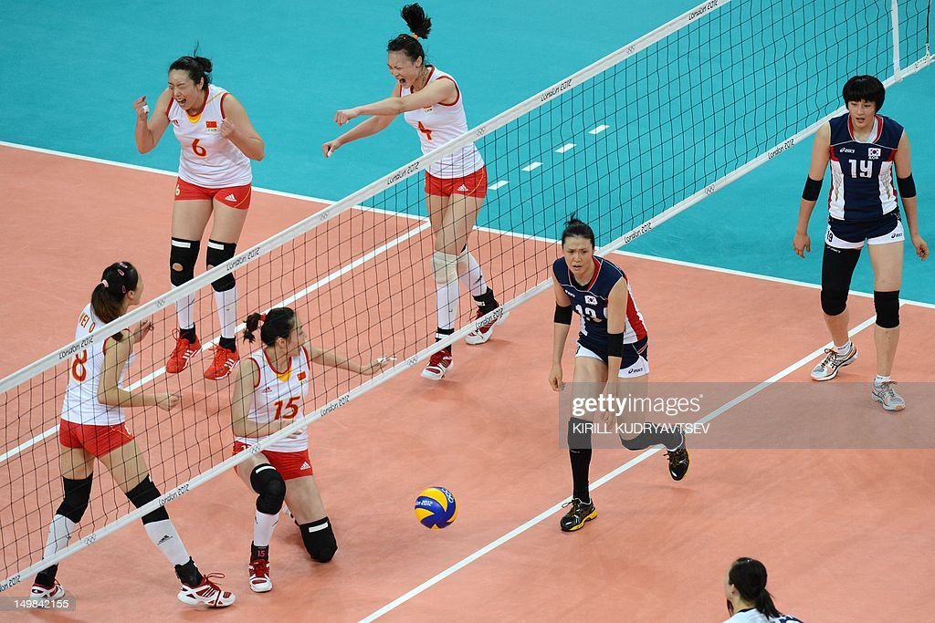 China's Hui Ruoqi (4), Chu Jinling (6), Wei Qiuyue (8) and Ma Yuwen (15) celebrate winning a point in front of South Korea's Jung Dae-Young (13) and Kim Hee-Jin during the Women's preliminary pool B volleyball match between China and South Korea in the 2012 London Olympic Games in London on August 5, 2012.