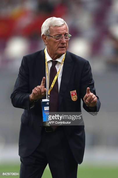 China's Italian Head Coach Marcello Lippi gestures during the FIFA World Cup 2018 qualification football match between Qatar and China at the Khalifa...