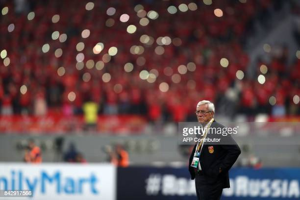 China's Italian Head Coach Marcello Lippi looks on during the FIFA World Cup 2018 qualification football match between Qatar and China at the Khalifa...