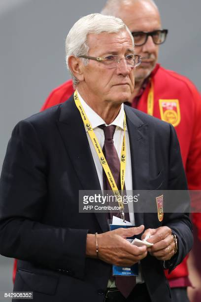 China's Italian Head Coach Marcello Lippi looks on prior to the start of the FIFA World Cup 2018 qualification football match between Qatar and China...
