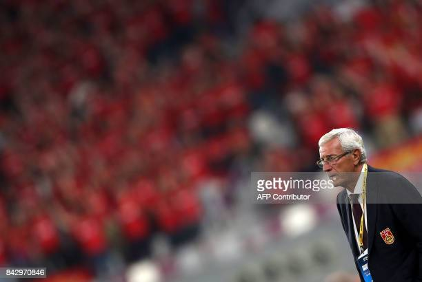 China's Italian Head Coach Marcello Lippi watches the FIFA World Cup 2018 qualification football match between Qatar and China at the Khalifa...