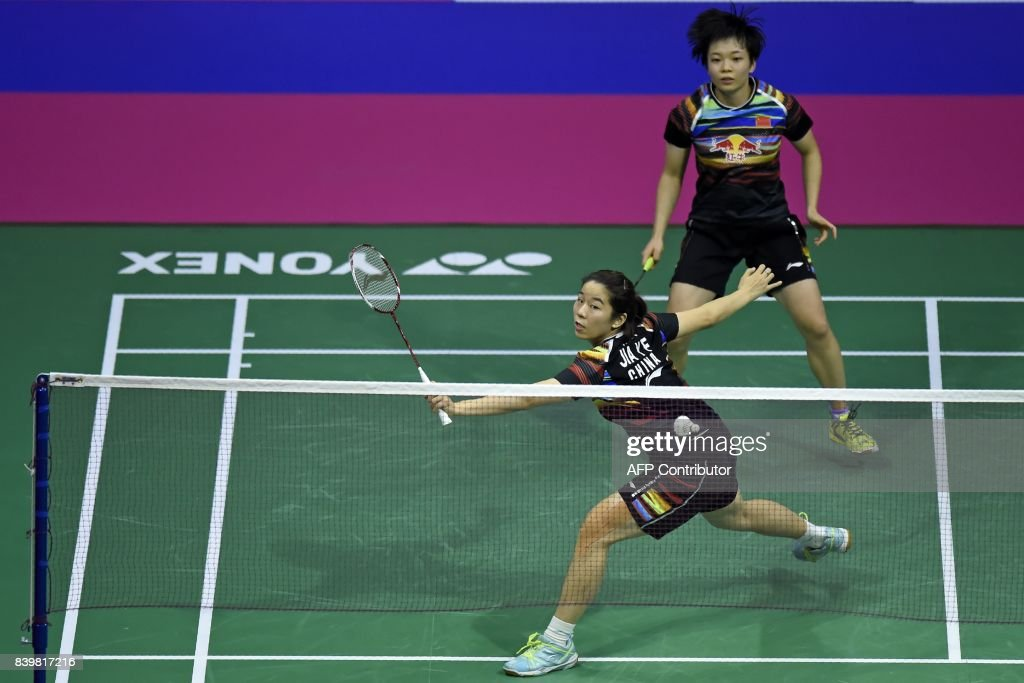 China's Jia Yifan (L) and Chen Qingchen return against Japan's Yuki Fukushima and Sayaka Hirota during their women's doubles final match during the 2017 BWF World Championships of badminton at Emirates Arena in Glasgow on August 27, 2017. /