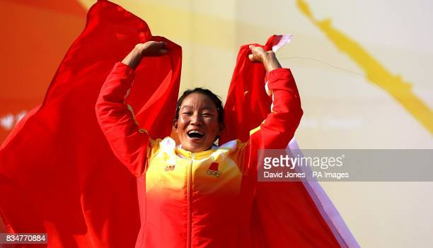China's Jian Yin celebrates winning her Gold Medal after the final round of the RSX Sailing Competition at the Olympic Games' Sailing Centre in...
