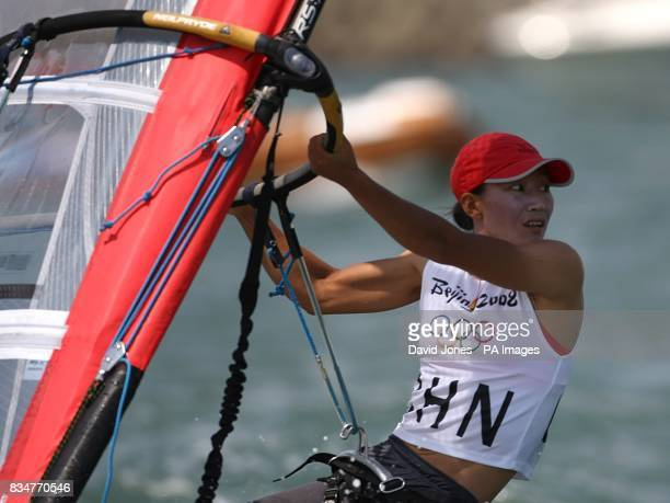 China's Jian Yin sails in the final round of the Women's RSX Sailing Competition at the Olympic Games' Sailing Centre in Qingdao on day 12 of the...