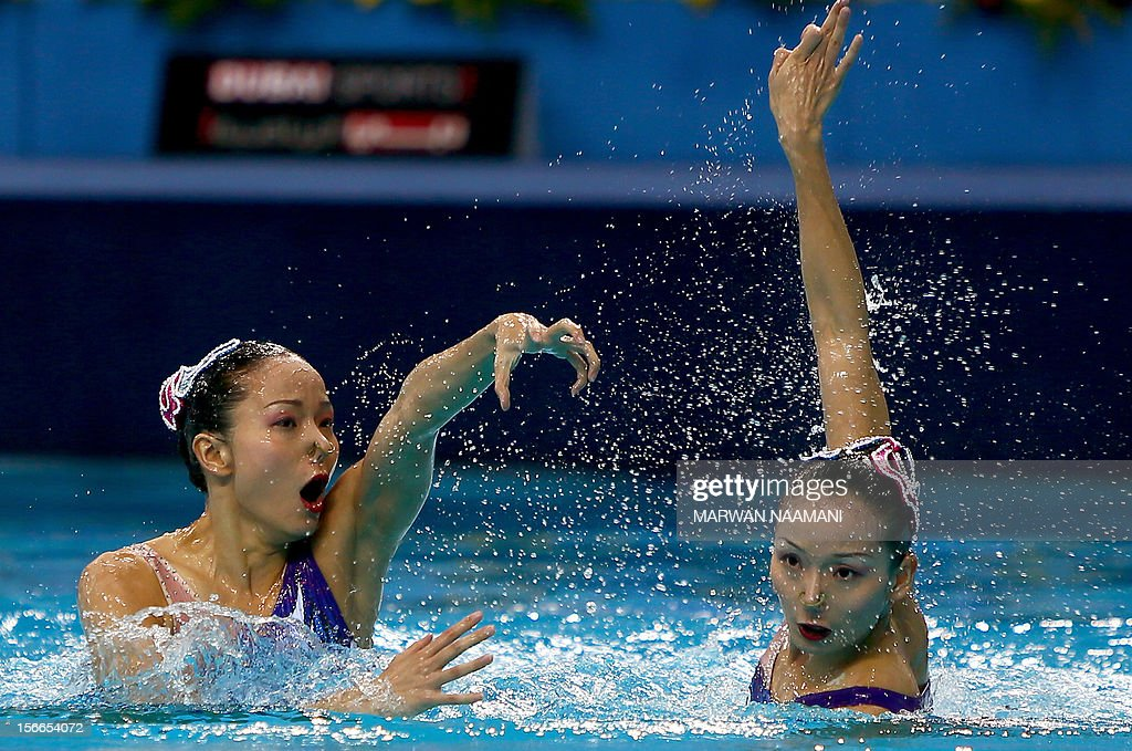China's Jiang Tingting and Jiang Wenwen perform in the Duets Free Routine Syncronised swimming final during the 9th Asian Swimming Championships in Dubai, on November 18, 2012. Chine won the gold medal.