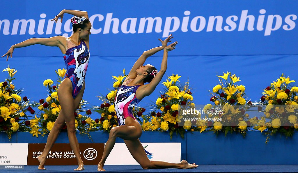 China's Jiang Tingting (L) and Jiang Wenwen perform in the Duets Free Routine Syncronised swimming final during the 9th Asian Swimming Championships in Dubai, on November 18, 2012. Chine won the gold medal.