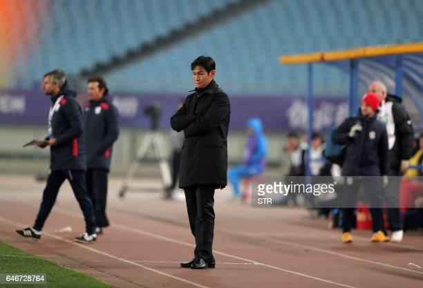 China's Jiangsu FC head coach Choi Yong Soo reacts during the AFC Champions League group stage football match against Australia's Adelaide United in...