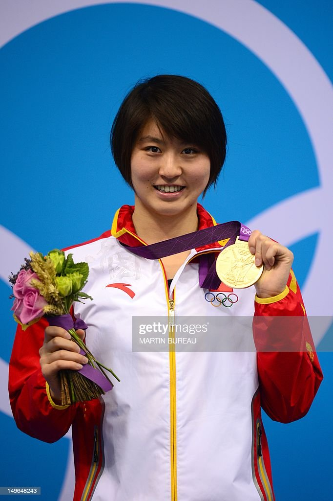 China's <a gi-track='captionPersonalityLinkClicked' href=/galleries/search?phrase=Jiao+Liuyang+-+Swimmer&family=editorial&specificpeople=4058032 ng-click='$event.stopPropagation()'>Jiao Liuyang</a> poses on the podium with the gold medal after the women's 200m butterfly final swimming event at the London 2012 Olympic Games on August 1, 2012 in London.