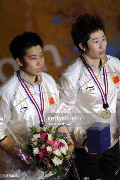 China's Jing Du and Yang Yu pose on the podium with their gold medal after defeating China's Jin Ma and Wiaoli Wang after the women doubles final of...
