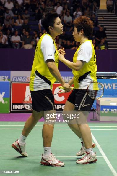 China's Jing Du and Yang Yu react as they celebrate their victory on Chinese Taipei's Wen Hsing Cheng and Yu Chin Chien during the women's double...