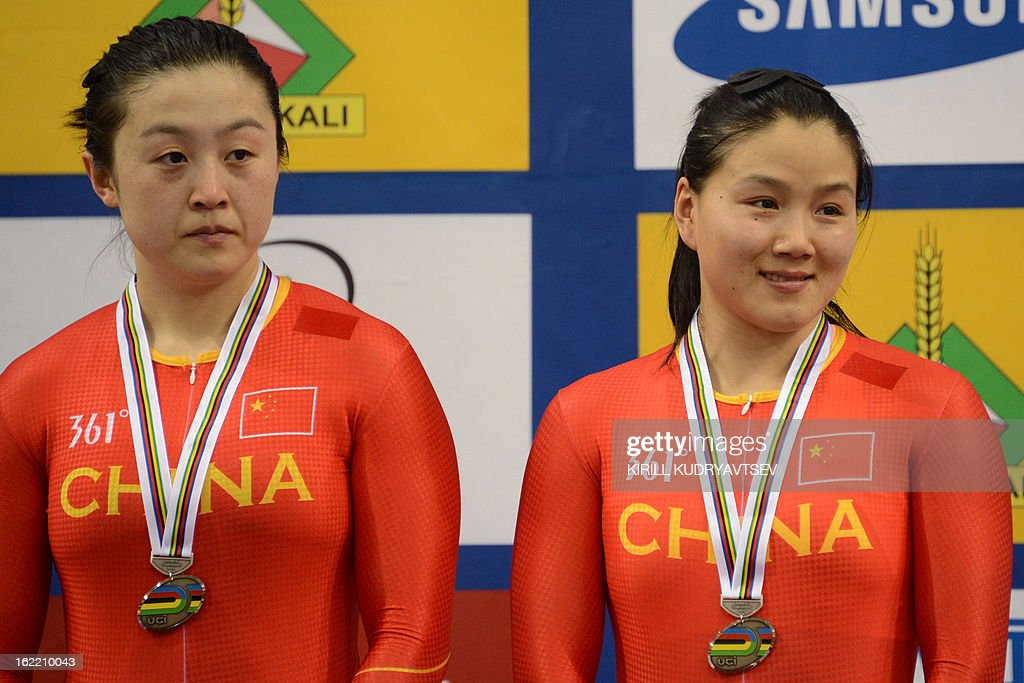 China's Jinjie Gong and Shuang Guo react with their silver medals after the UCI Track Cycling World Championships women's team sprint in Minsk on February 20, 2013.