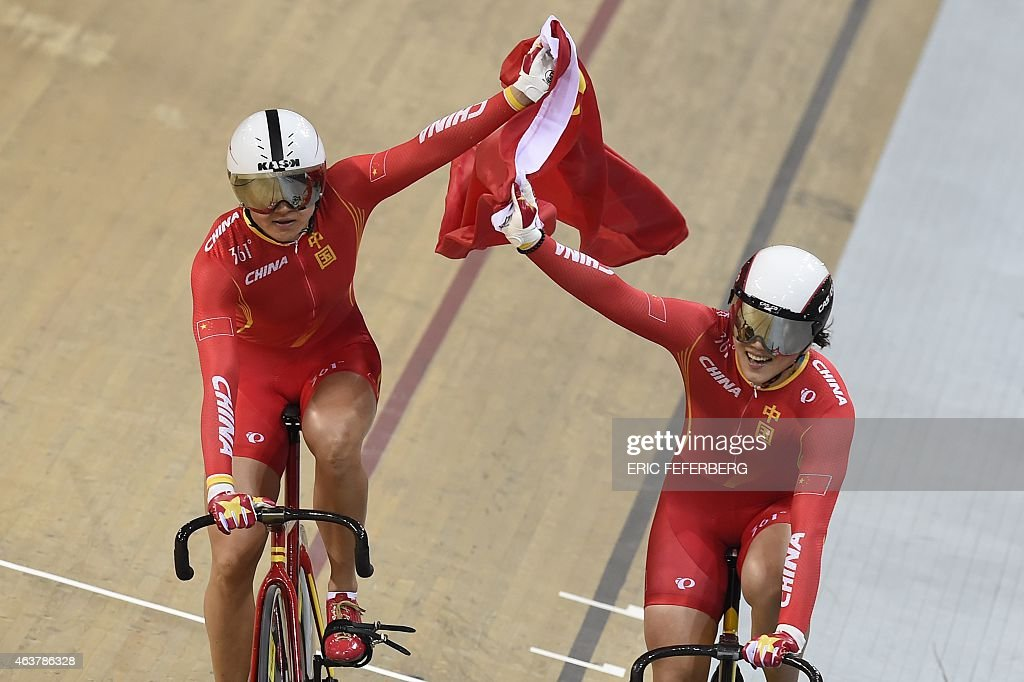 China's Jinjie Gong (R) and Tianshi Zhong celebrate after coming in first and setting a new world record in the Women's Team Sprint finals at the UCI Track Cycling World Championships in Saint-Quentin-en-Yvelines, near Paris, on February 18, 2015.