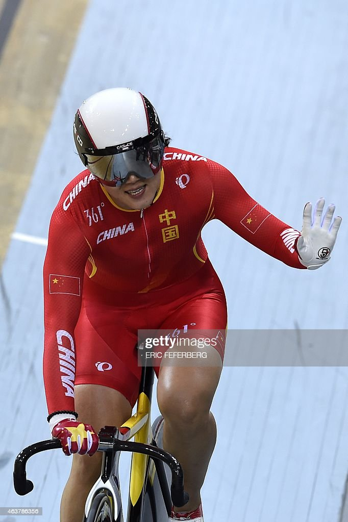 China's Jinjie Gong celebrates after coming in first and setting a new world record in the Women's Team Sprint finals at the UCI Track Cycling World Championships in Saint-Quentin-en-Yvelines, near Paris, on February 18, 2015. AFP PHOTO / ERIC FEFERBERG