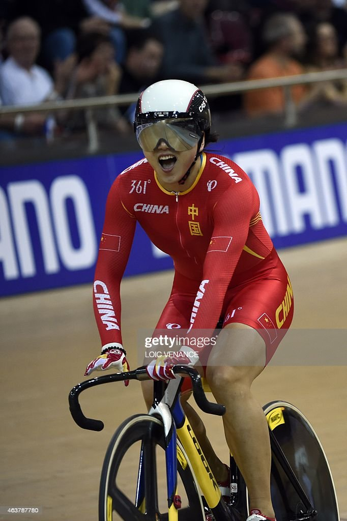 China's Jinjie Gong celebrates after coming in first and setting a new world record in the Women's Team Sprint finals at the UCI Track Cycling World Championships in Saint-Quentin-en-Yvelines, near Paris, on February 18, 2015. AFP PHOTO / LOIC VENANCE