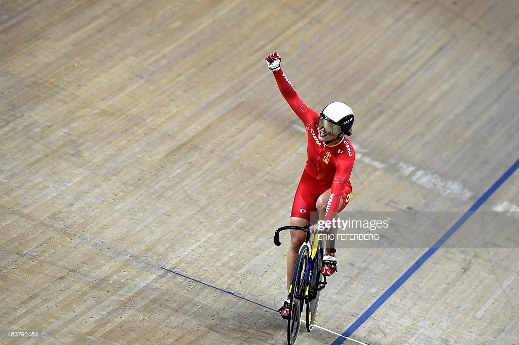 China's Jinjie Gong celebrates after coming in first and setting a new world record in the Women's Team Sprint finals at the UCI Track Cycling World Championships in Saint-Quentin-en-Yvelines, near Paris, on February 18, 2015.