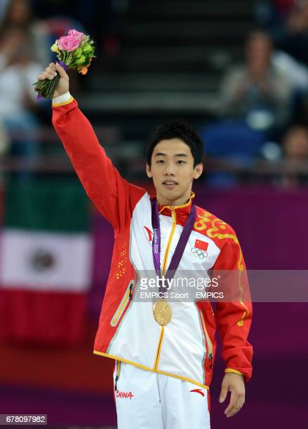 China's Kai Zou celebrates winning gold the Artistic Gymnastics men's Floor final at the North Greenwich Arena London