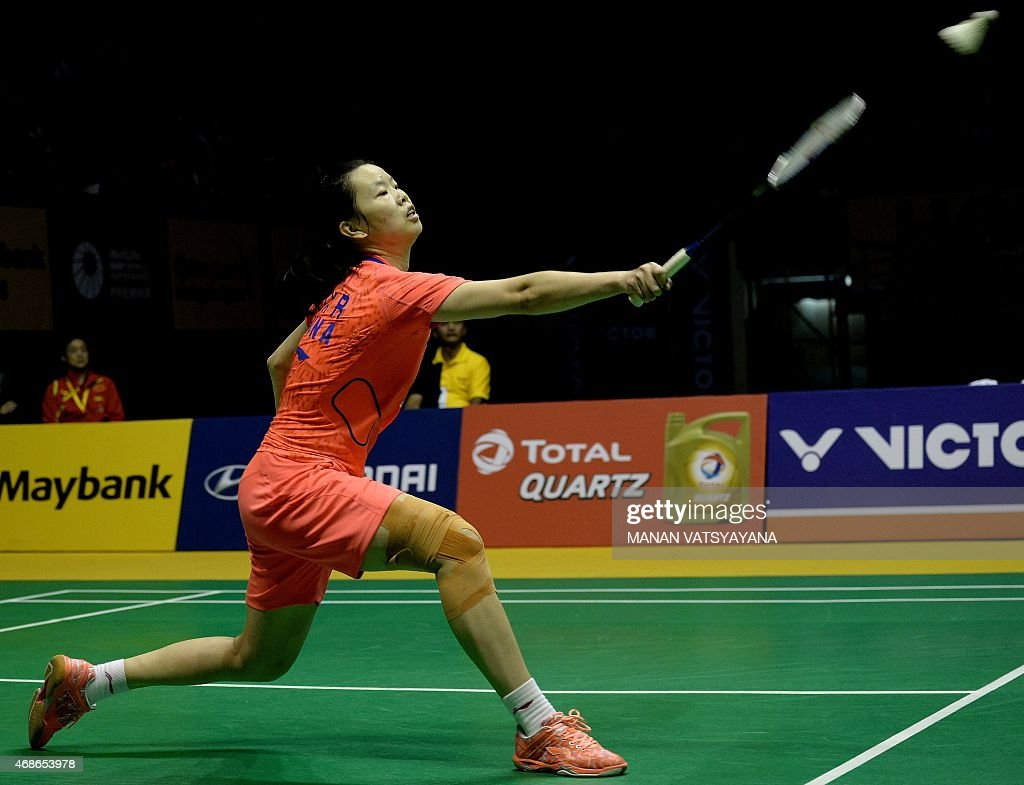 China s Le Xuerui returns a shot against Carolina Marin of Spain