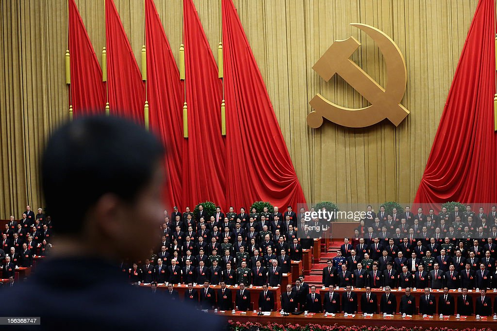 China's leaders stand as they listen to 'the Internationale' during the closing session of the 18th National Congress of the Communist Party of China (CPC) inside the Great Hall of the People on November 14, 2012 in Beijing, China. Members of the Standing Committee of the Political Bureau of the new CPC Central Committee will meet with journalists on November 15, 2012.