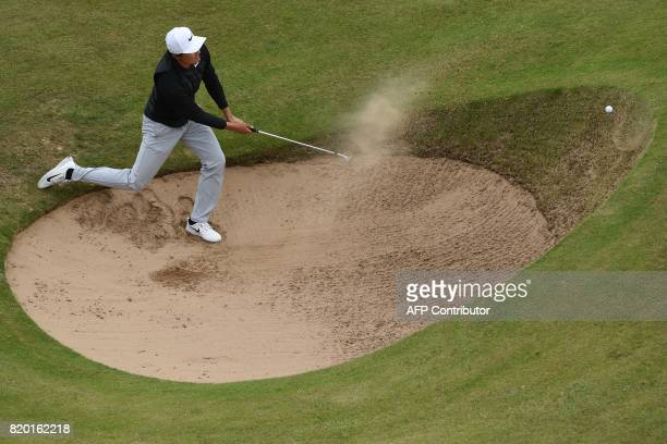 TOPSHOT China's Li Haotong fails to get out of a bunker on the 12th hole during his second round on day two of the Open Golf Championship at Royal...