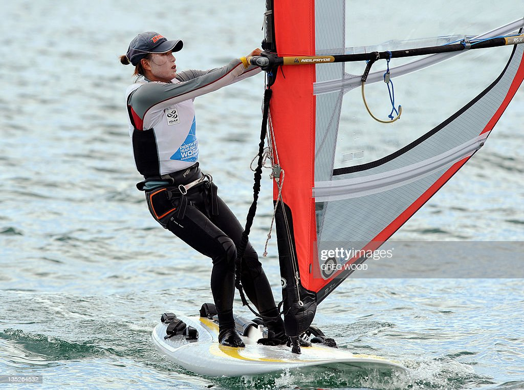 China's Li Ling crosses the finish line to complete the first Gold Fleet race in the